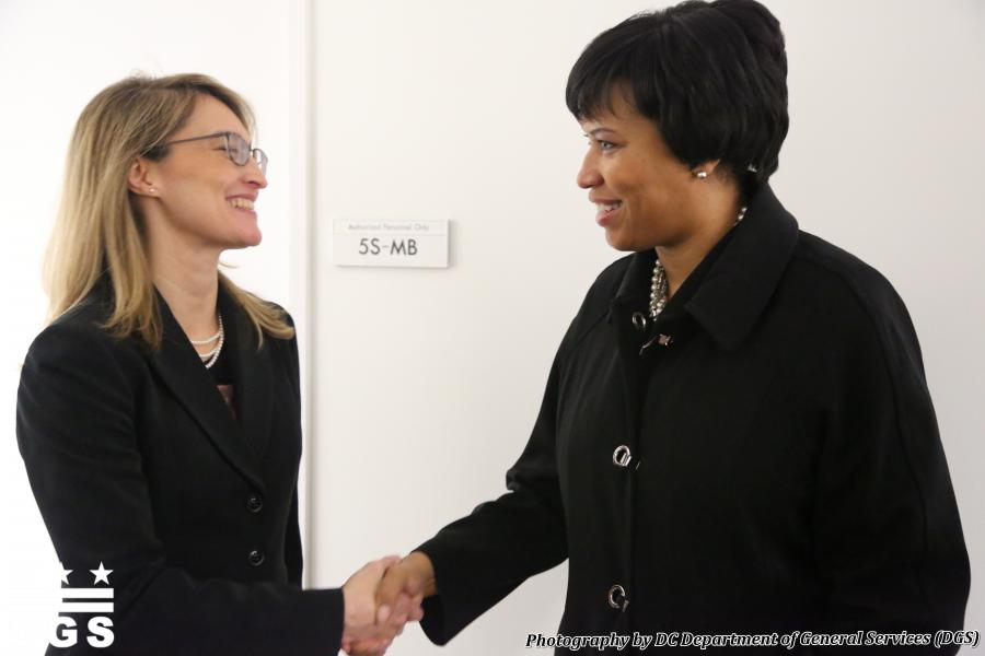 DC Office of Human Rights Director Monica Palacio shakes hands with DC Mayor Muriel Bowser