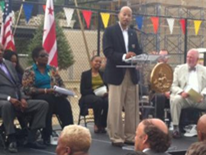 SETLC Topping Off Ceremony - DC Mayor's Chief of Staff, John Stokes, on dias (Image 4)
