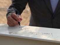 SETLC Topping-Off Ceremony - Mayor Vincent Gray signing the last piece of iron to top-off the building (Image 2)