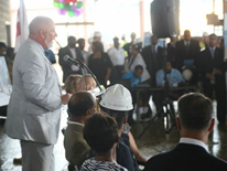 Brian Hanlon (DGS Director) speaking to crowd - Ballou High School 'Topping Out' Ceremony