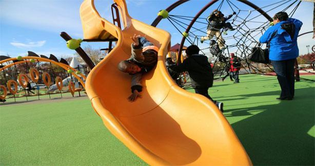 Boy sliding down yellow slide