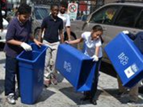 "The Ross Recycling Team dumps water from their recycling bins after completely their ""Recycling Bin Dance."""