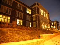 Cardozo High School - facade illuminated at night