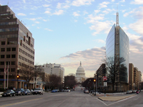 DGS Portfolio Management Division - a typical business district street in DC with the US Capitol in the background