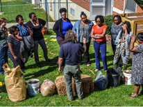 Teachers and staff from Randle Highlands learn about managing their on-site garden compost bin provided by DGS and Benny Erez of ECO City Farms.