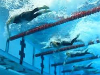 Swimmers racing in lanes underwater in a DC Pool