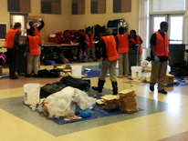 Teams of Walker-Jones sixth grade students sort through their school's kitchen and cafeteria waste to gather data on the waste streams created from their school lunches.